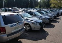 A parking lot outside a UVA dorm was filled with hundreds of state police cruisers on Wednesday afternoon. (Ned Oliver/Virginia Mercury - Aug. 8, 2018)