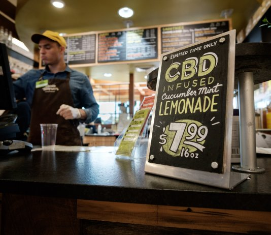 A sign advertises CBD lemonade at Ellwood Thompson's, an organic grocer in Richmond. (Ned Oliver/Virginia Mercury)